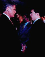 US President Bill Clinton, congratulates Eric Malone after a ceremony honoring his heroic rescue efforts during the '96 Floods in the State of Pennsylvania. Eric is presented with a Commendation from the White House.